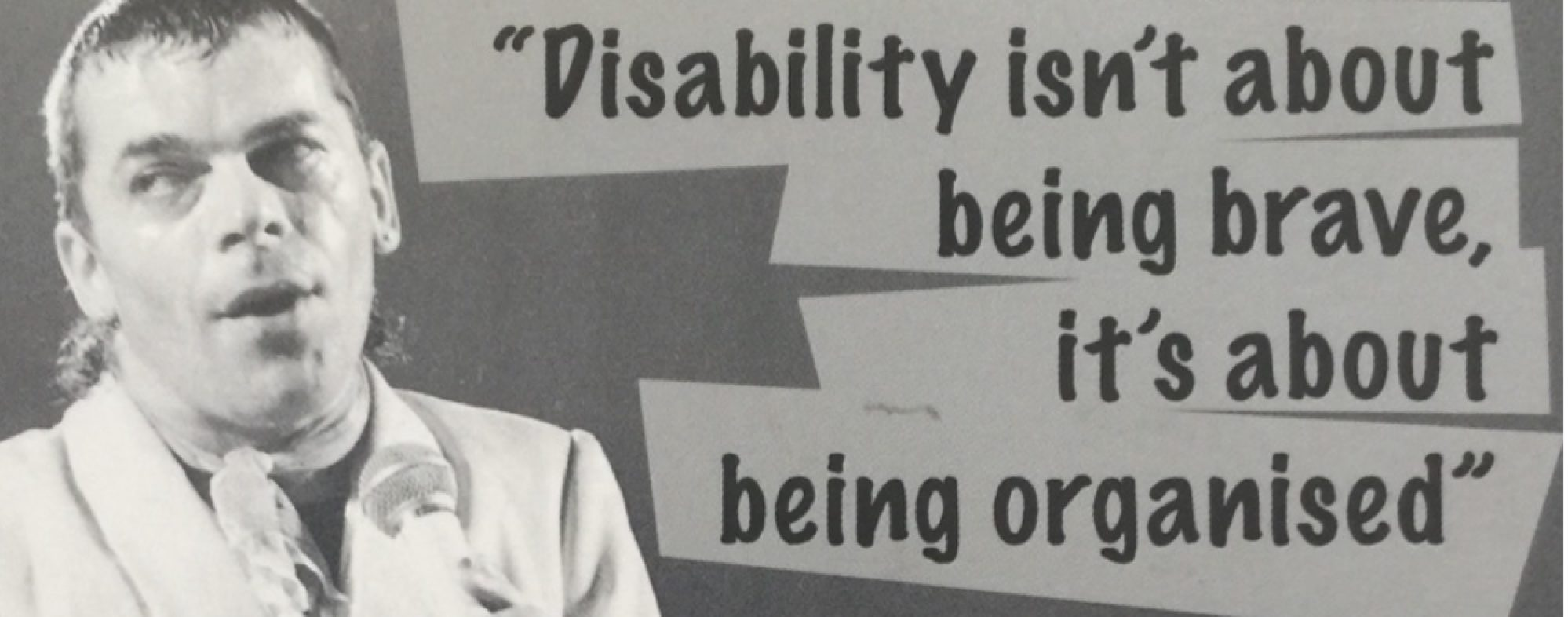 A poster image of Ian Dury with a quote that reads: Disability isn't about being brave, it's about being organised.