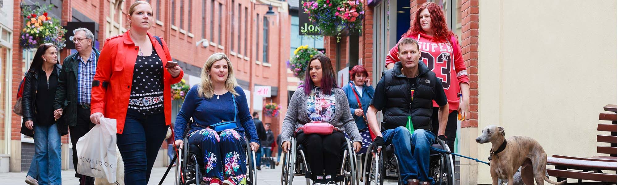 A candid photograph of five Difference trustees making their way through Durham City Centre.